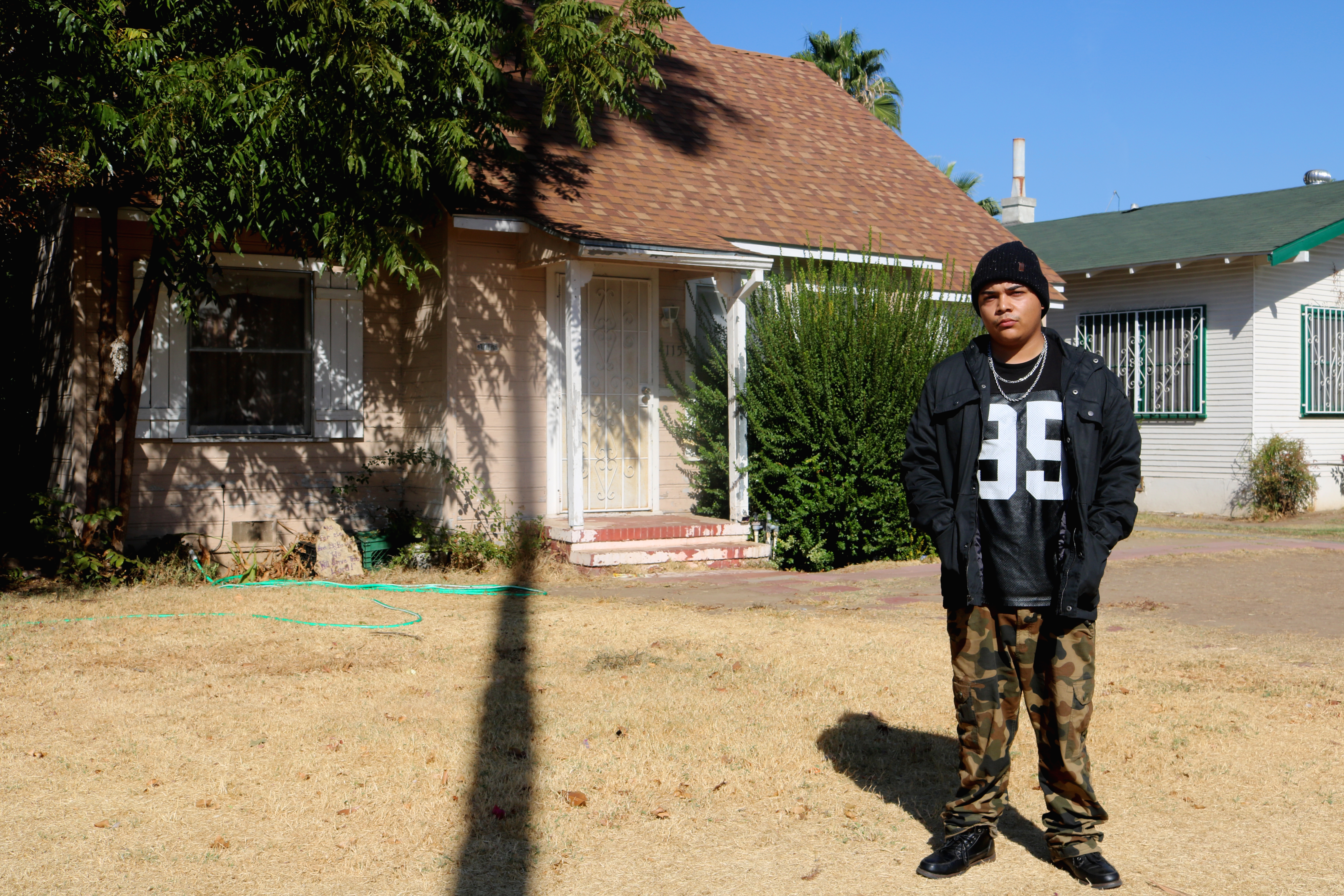 Reyna in front of what is now his Grandmother's home, where he spent the last 9 years of his life.